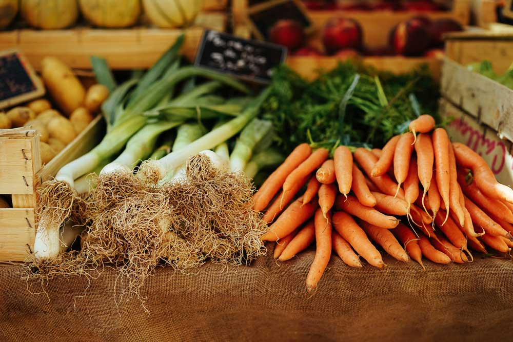 food trends 2017 local produce, fresh food at the market carrots and onions